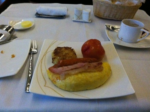Spanish omelette with bacon and sausage